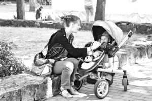 mother with baby in pushchair, unable to work