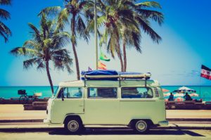 campervan parked by a beach and palm trees ,on holiday